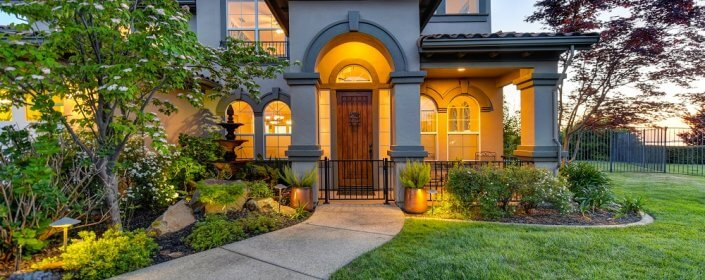 Gated front entry of a beautiful rustic home presenting a safety door